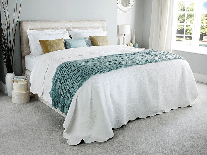 A dressed Comfomatic bed