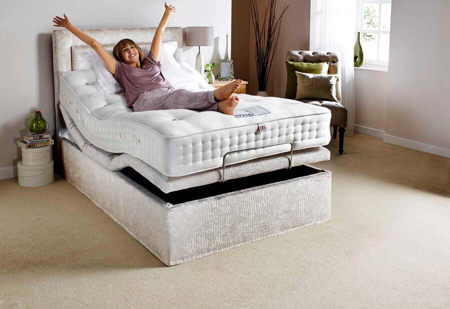 A lady laying on a Comfomatic bed