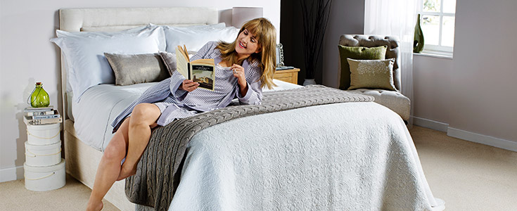 A woman reading on a Comfomatic bed