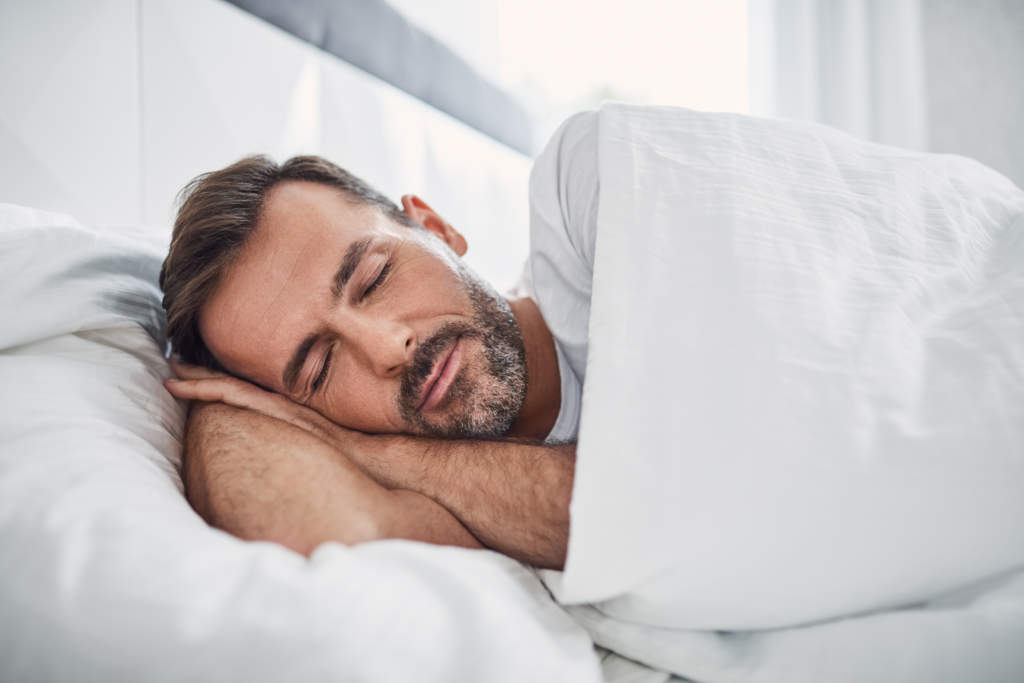A man asleep in bed